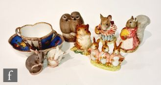Four assorted Beswick Beatrix Potter figurines comprising Timmy Willie, Mrs Tittlemouse, Goody