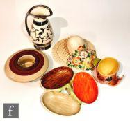Five pieces of assorted 1930s Art Deco pottery comprising a Solian Ware wall pocket, a Myott nut