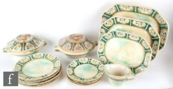 A 1920s Frank Brangwyn for Royal Doulton part dinner service comprising three graduated meat plates,