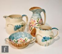 Four pieces of 1930s Art Deco Myott comprising a 'Chicken Neck' jug decorated in the hand painted