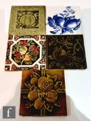 Five assorted early 20th Century 6in dust pressed tiles decorated with fruit and foliage to