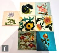 Seven assorted early 20th Century 6in Art Nouveau dust pressed tiles each with a floral design to