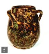 An early 20th Century Fulham Pottery Hurlingham vase of swollen barrel form with three wrythen