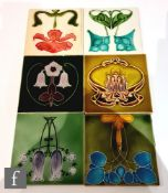 Six assorted early 20th Century 6in Art Nouveau tiles each with a stylised floral motif, to