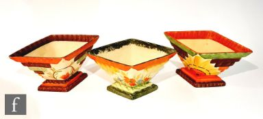 Three 1930s Myott Art Deco diamond shaped planters, the first in the 8514 pattern with orange