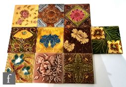 Ten assorted early 20th Century 6in Art Nouveau dust pressed tiles, to include a J.H Barratt & Co