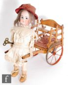 A late 19th Century French Roullet et Decamps girl pulling a cart automaton, circa 1890, the Limoges