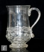 An early 18th Century tankard circa 1700, of baluster form with applied strap handle, with moulded