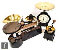 A set of Gallenkamp balance scales by ETA Insts Ltd, a set of part brass Libra scales, an EKC