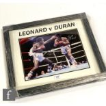 A Leonard V Duran boxing action ring shot, signed by both boxers, certificate to reverse, 30cm x