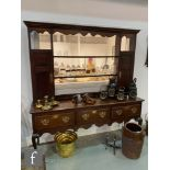 A George III and later oak dresser inlaid with a chequer strung plank top over three drawers,