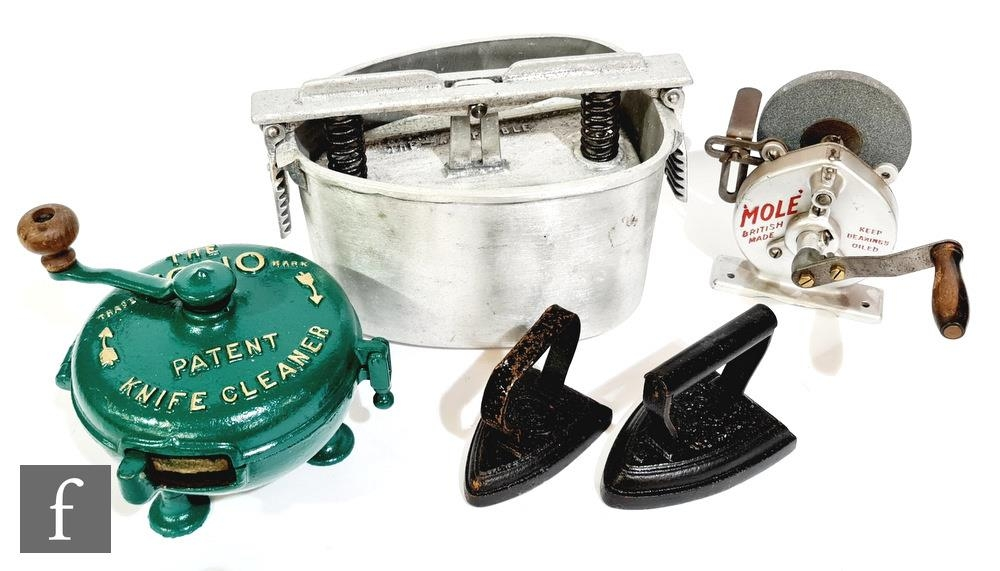 A Vono circular knife grinder, later green painted, a Mole hand crank operated grinder, two flat