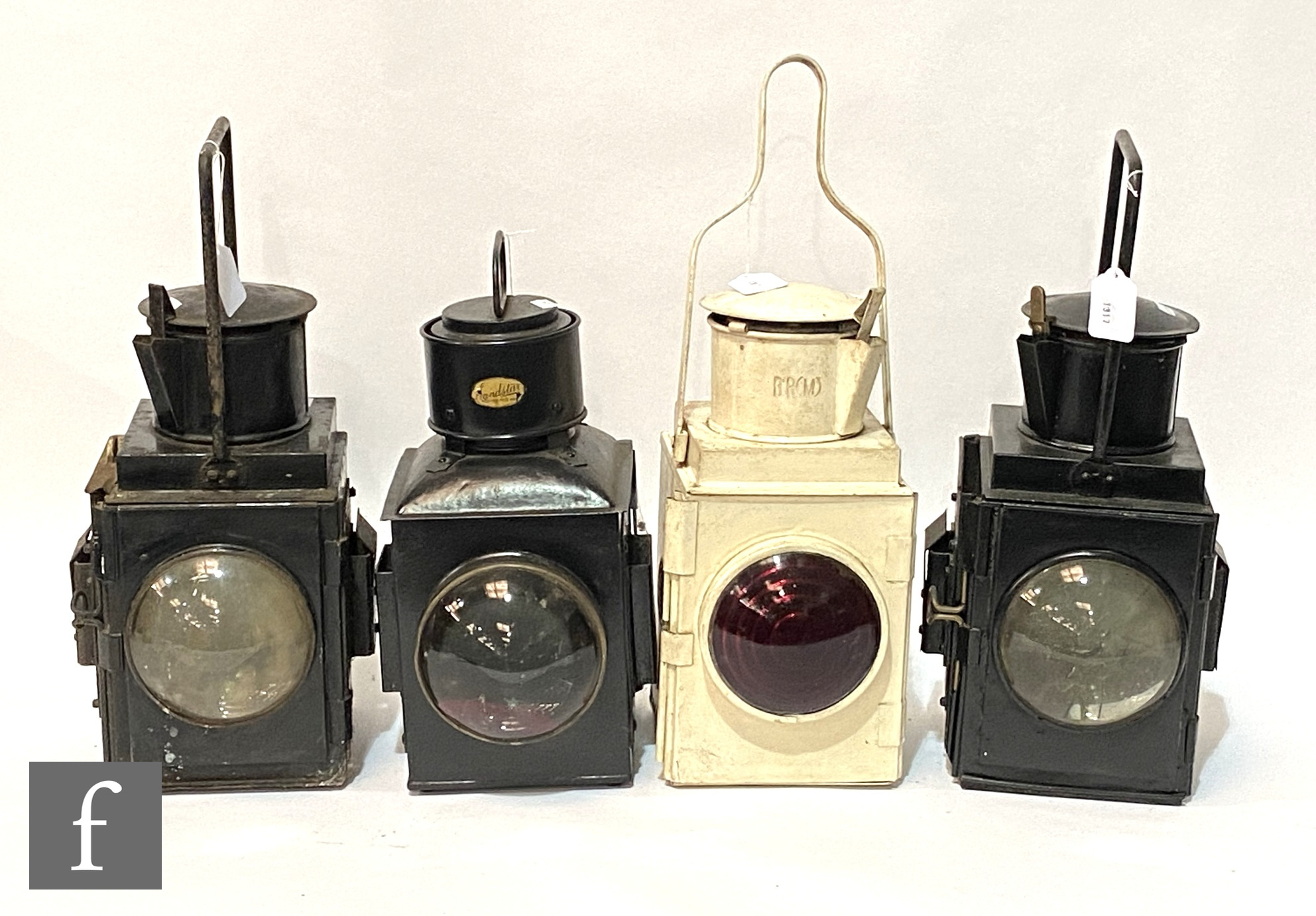 Two BR black painted guards hand lamps, a white painted BR(M) hand lamp and a Sandstar guards