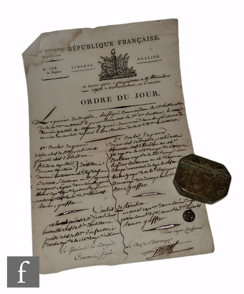 A single sheet of paper titled Republique Francois Ordre Du Jour, with a small brass octagonal snuff