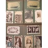 Two early 20th Century postcard albums containing approximately three hundred cards, including