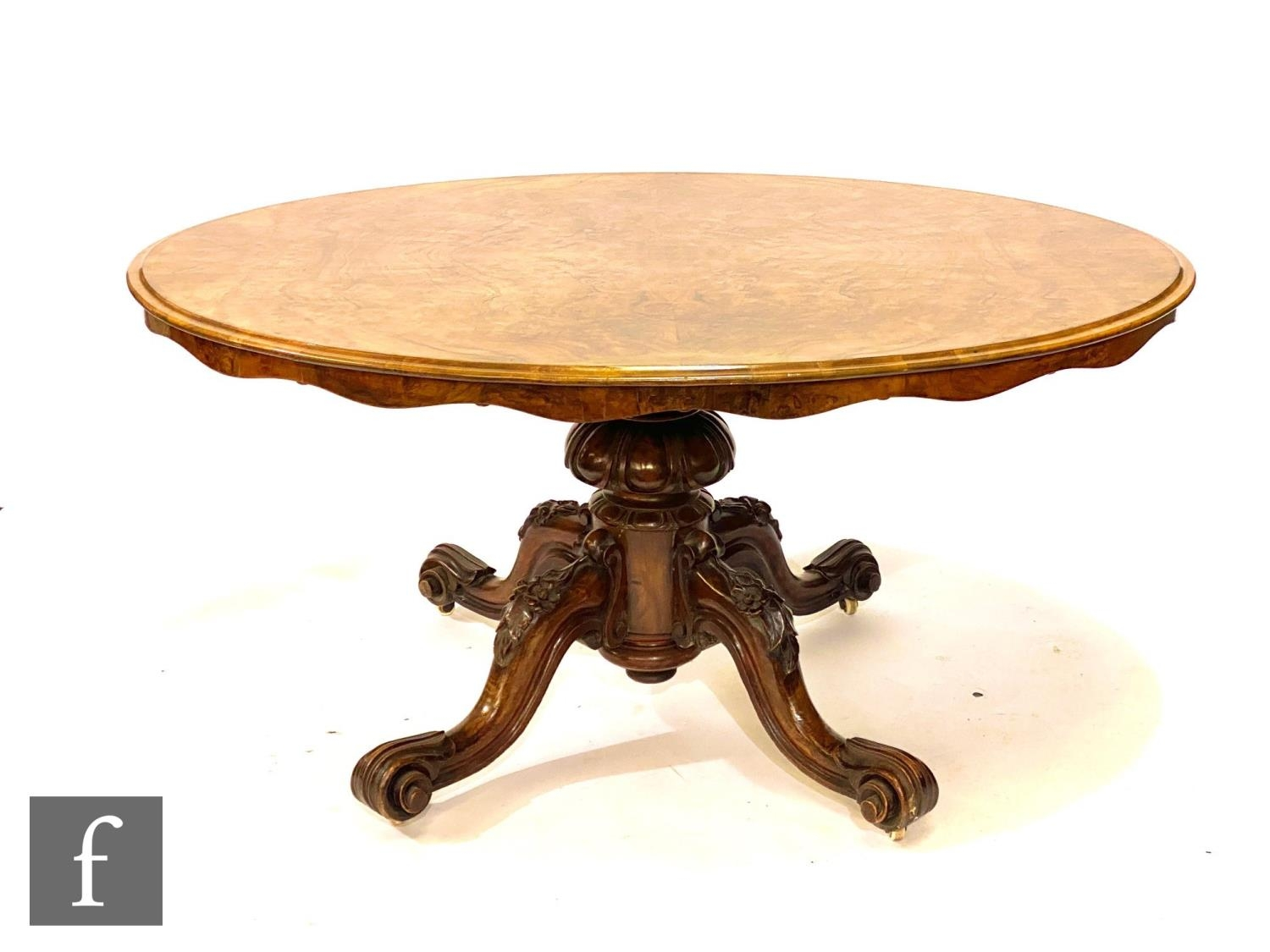A Victorian figured walnut tilt top oval breakfast table on turned melon form pedestal and four