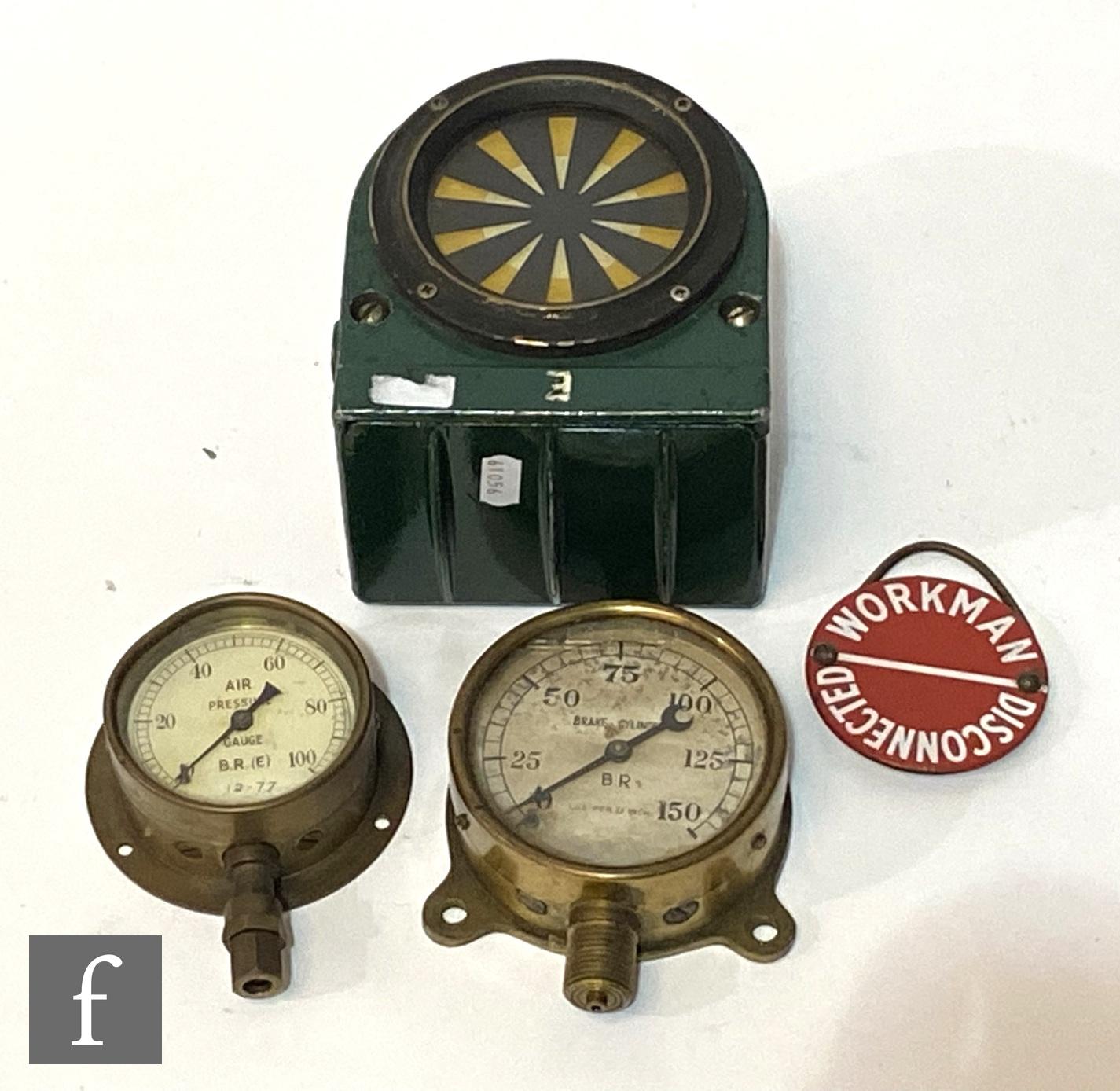 An AWS indicator painted green, height 15cm, a brass brake cylinder gauge, diameter 9cm, a BR (E)
