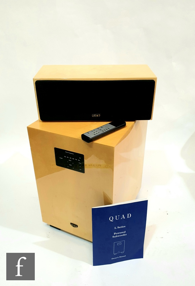 A Quad L series powered subwoofer, serial number QS000008M, with remote control and instruction