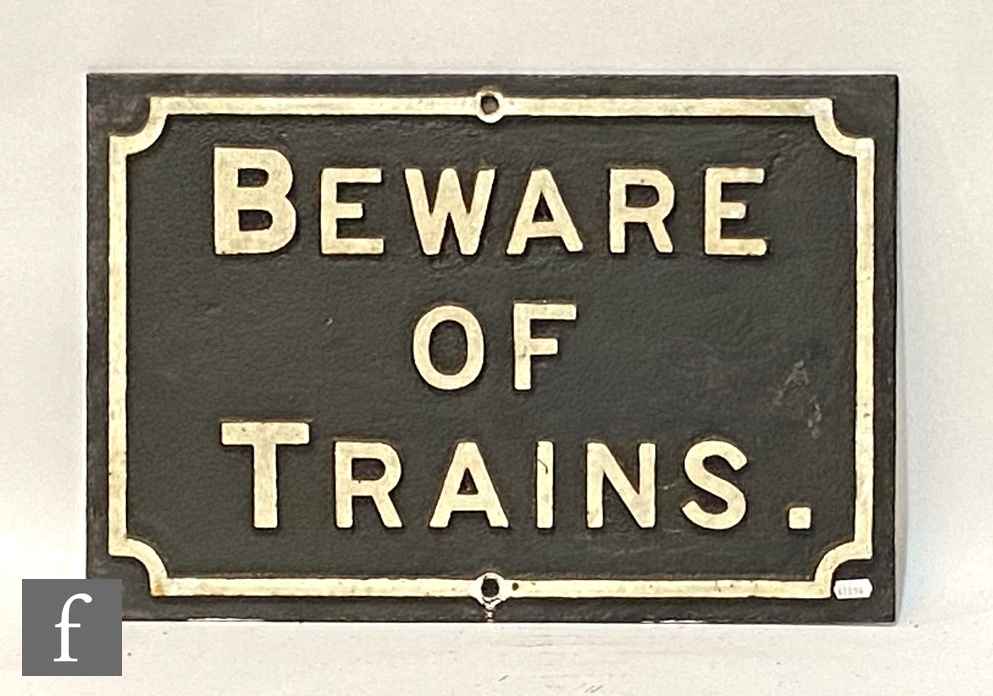 A cast iron Midland Railway 'Beware of Trains' sign, white lettering on black background, 38cm x