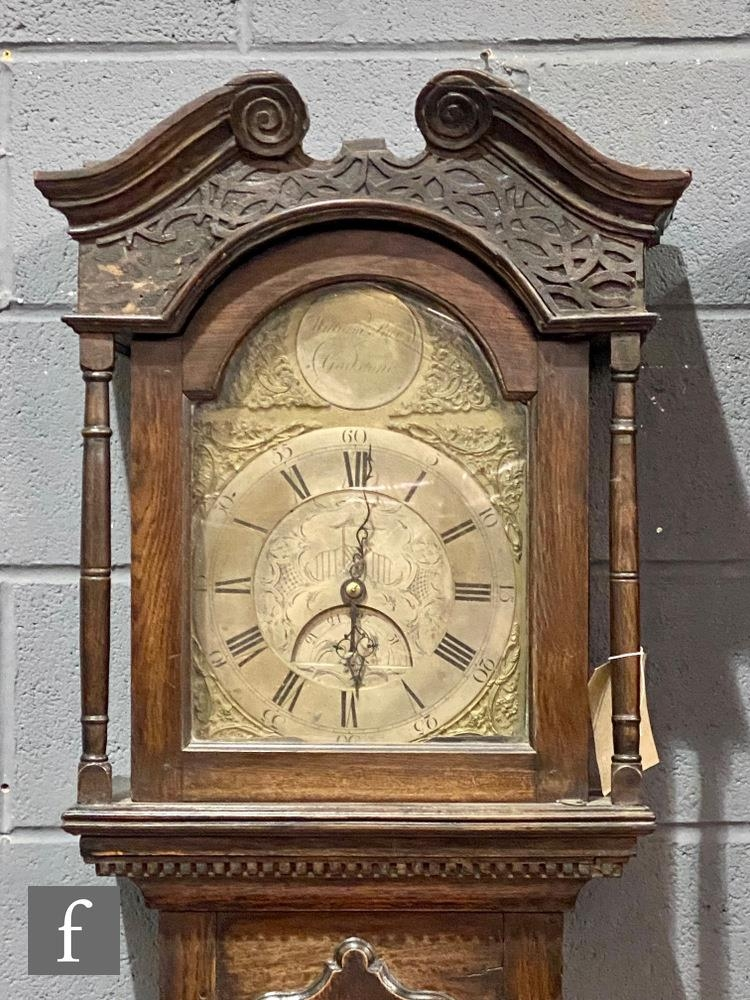 A late 18th Century oak longcase clock with a thirty-hour movement striking on a bell, the twin