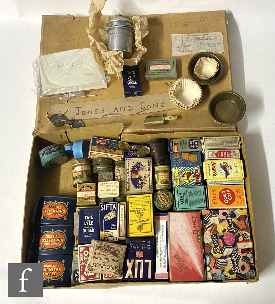 A collection of early 20th Century packaging, mostly miniature sample tins and similar, collated