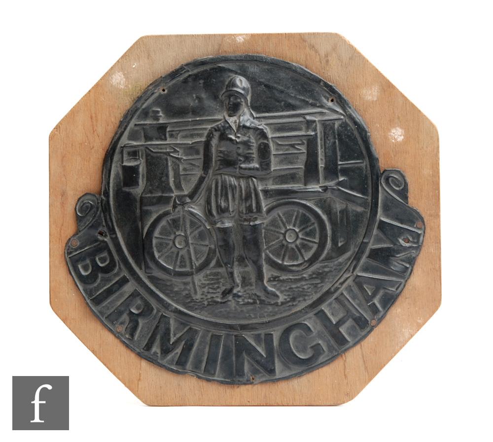 A Birmingham pressed copper firemark, mounted on a board, width 28cm.