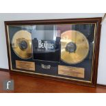 A Beatles limited edition 24 carat gold plated Past Masters Volume One & Two, the presentation