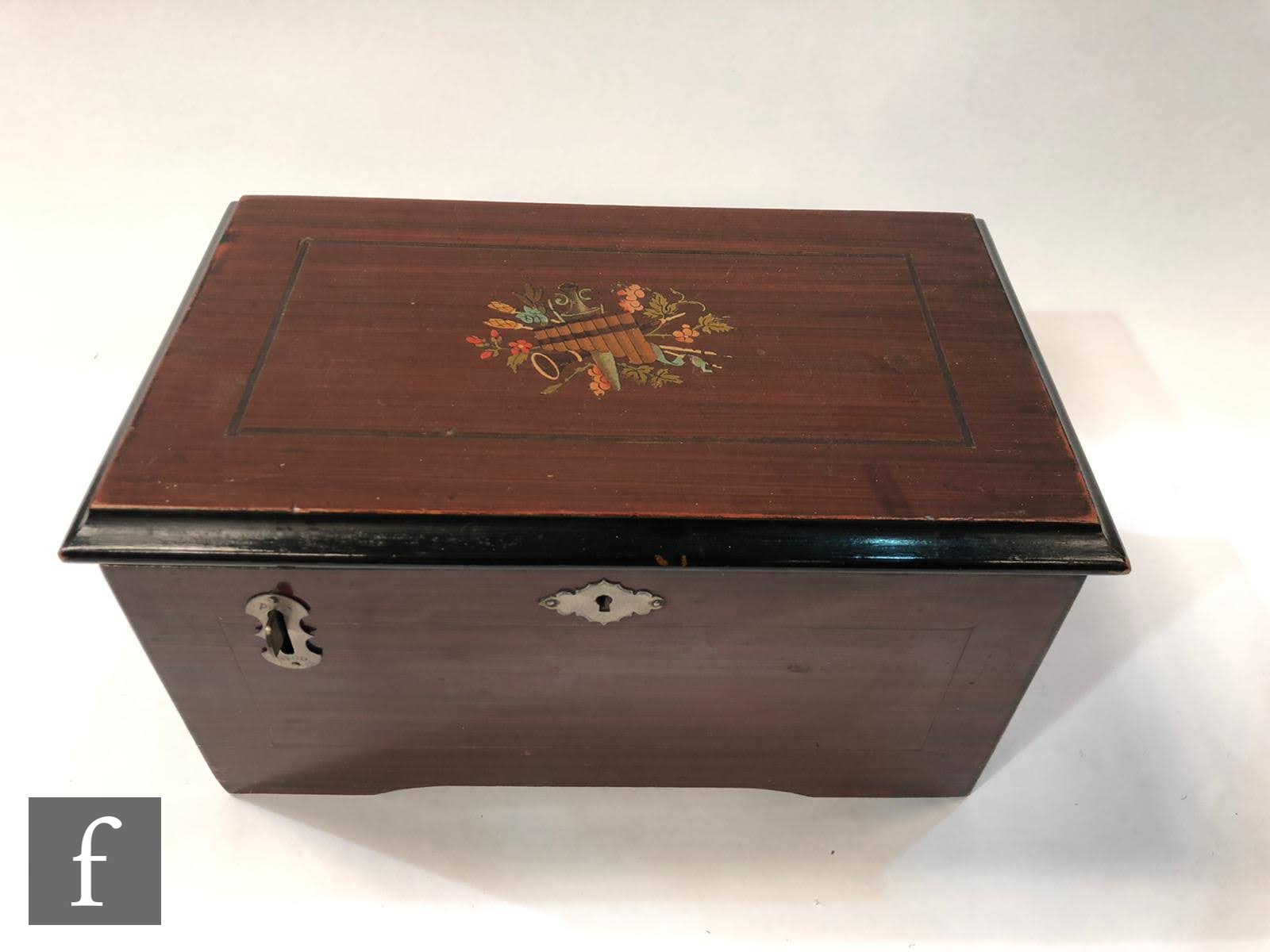 A Britannia disc musical box playing 5 inch discs, lever operation, transfer detail to lid and