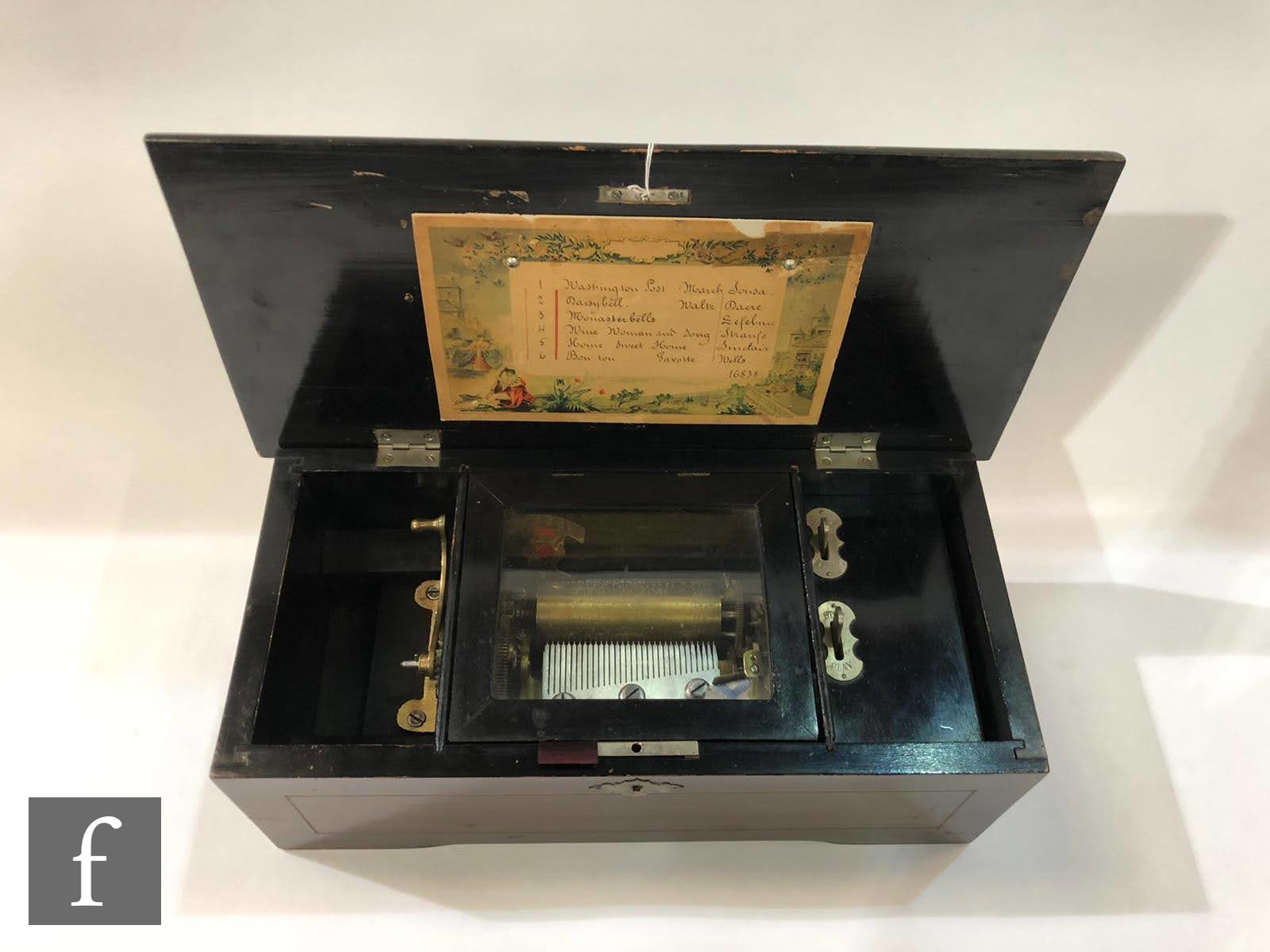 A musical box, serial No 16838, playing six airs, printed tune card, simulated rosewood case with - Image 2 of 2