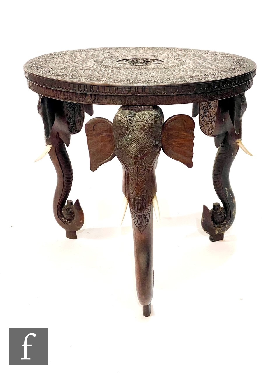 A 20th Century ebonised jardiniere stand on slender elephant style legs, diameter 36cm, and a