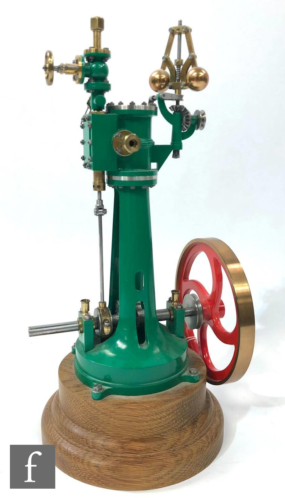 A vertical live steam engine with single oscillating cylinder and centrifugal governor, painted in