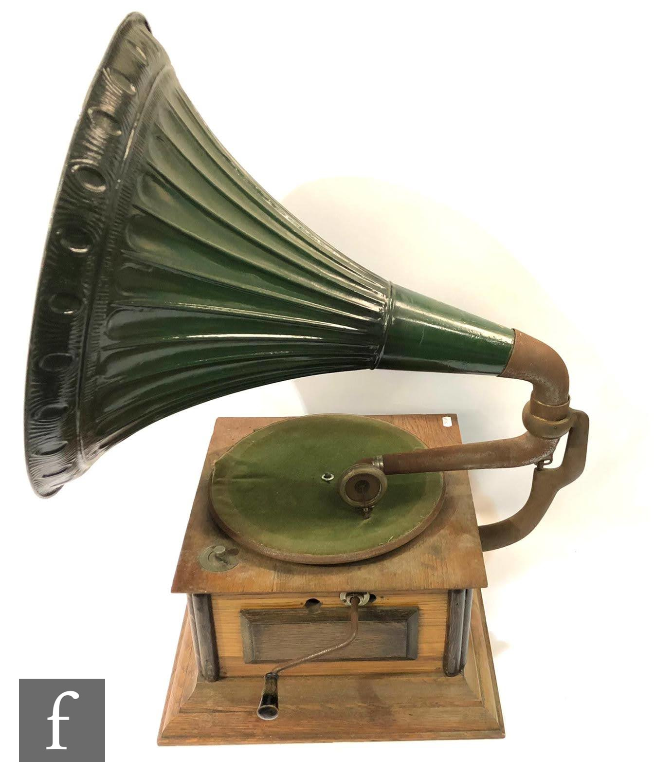 An Academy oak cased wind up horn gramophone with green tin horn, complete with winder and