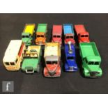 A collection of Dinky diecast model commercial vehicles, comprising 411 Bedford Truck in mid green