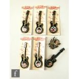 A set of five The Fabulous Beatles jewellery brooches shaped as guitars, with original backing
