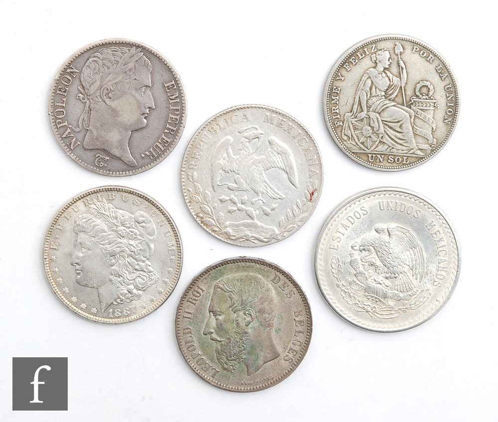 An American Morgan dollar 1887, Mexicana 1891 dollar, 1948 five Pesos, 1924 Peru five Decimos,