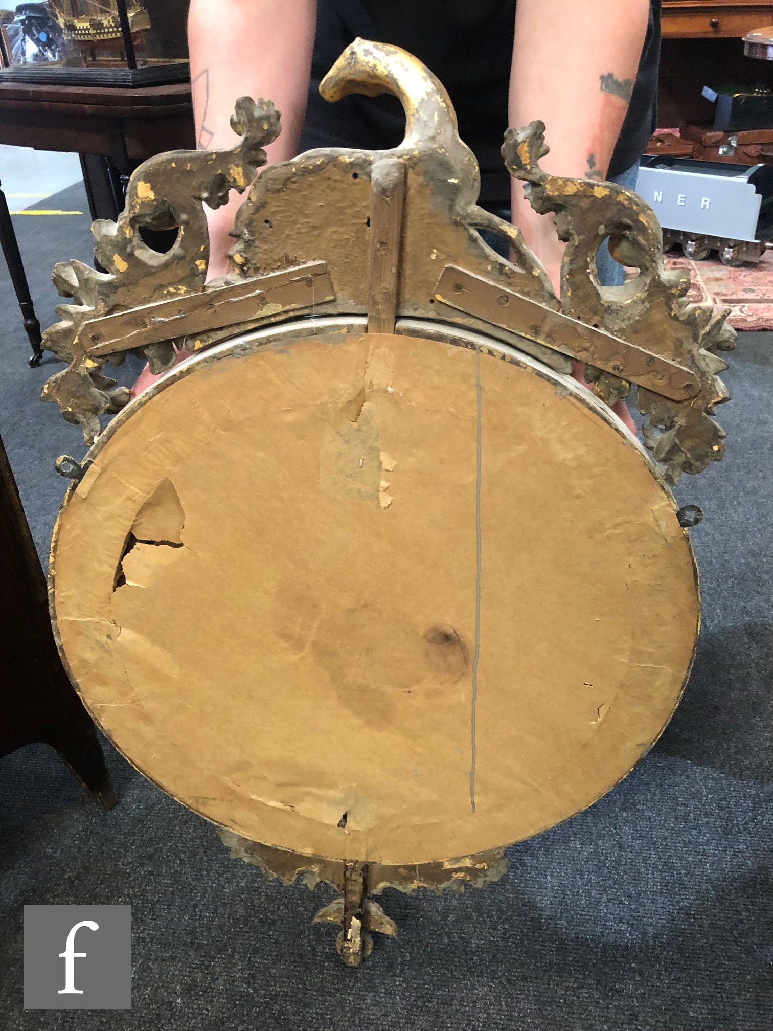 A 19th Century circular gilt wall mirror, the raised frame surmounted with a resting deer flanked by - Image 2 of 2