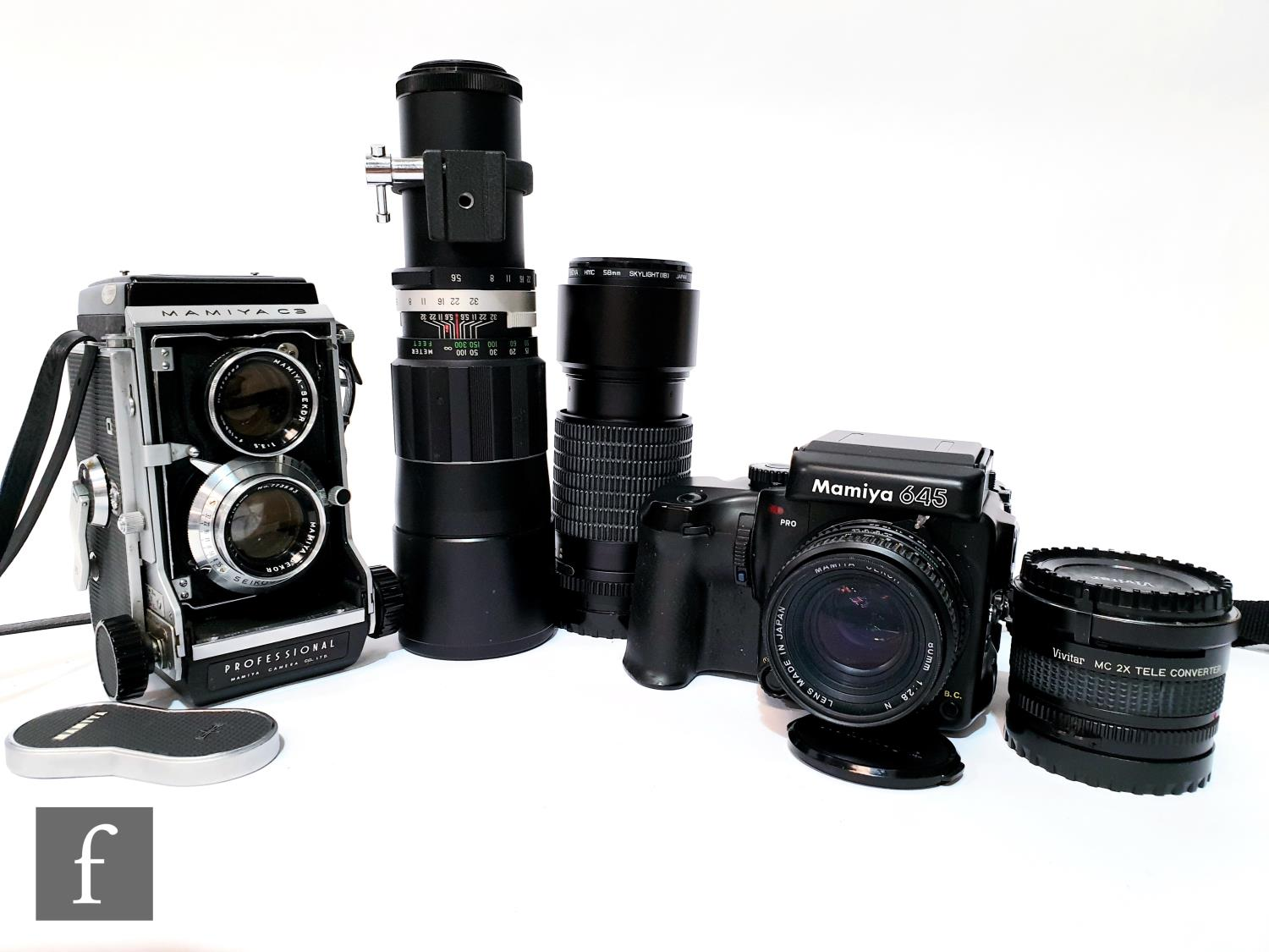 A Mamiya C3 TLR camera, a Mamiya 645 with four interchangeable lenses including a Solligor telephoto