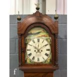 A 19th Century mahogany longcase clock with an eight-day movement striking on a bell, the hood