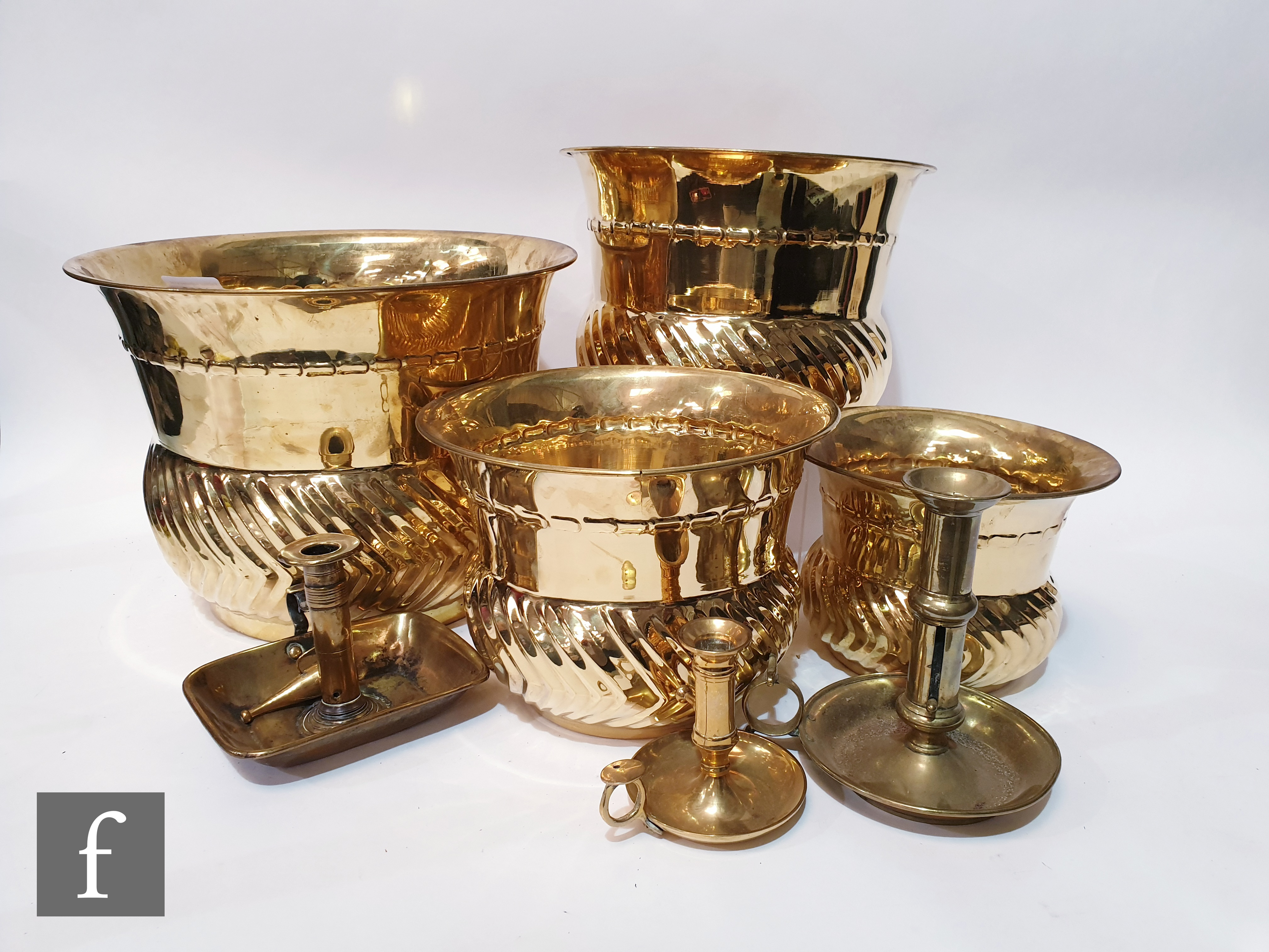 A contemporary graduated set of four Indian brass jardinières with gadroon decoration, together with