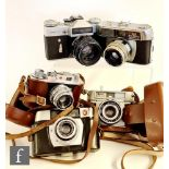 A collection of vintage 35mm rangefinder cameras, to include a Zenite- E, serial number 67025946,