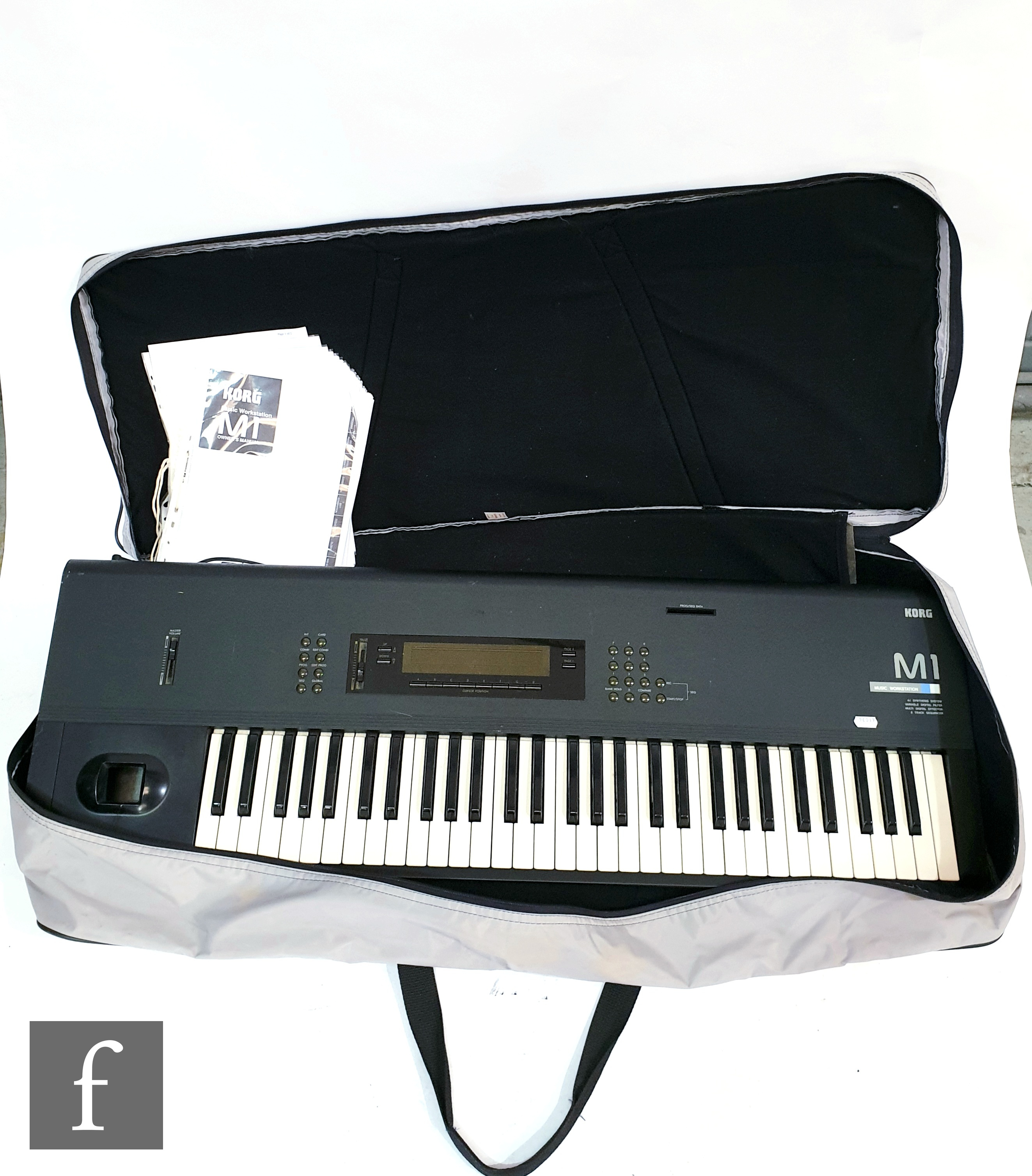 A Korg M1 Music station synthesizer, serial number 084274, sold with bag, leads and instruction