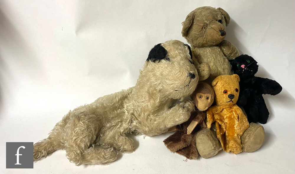 A mid 20th Century blonde mohair teddy bear with amber and black glass eyes, vertically stitched