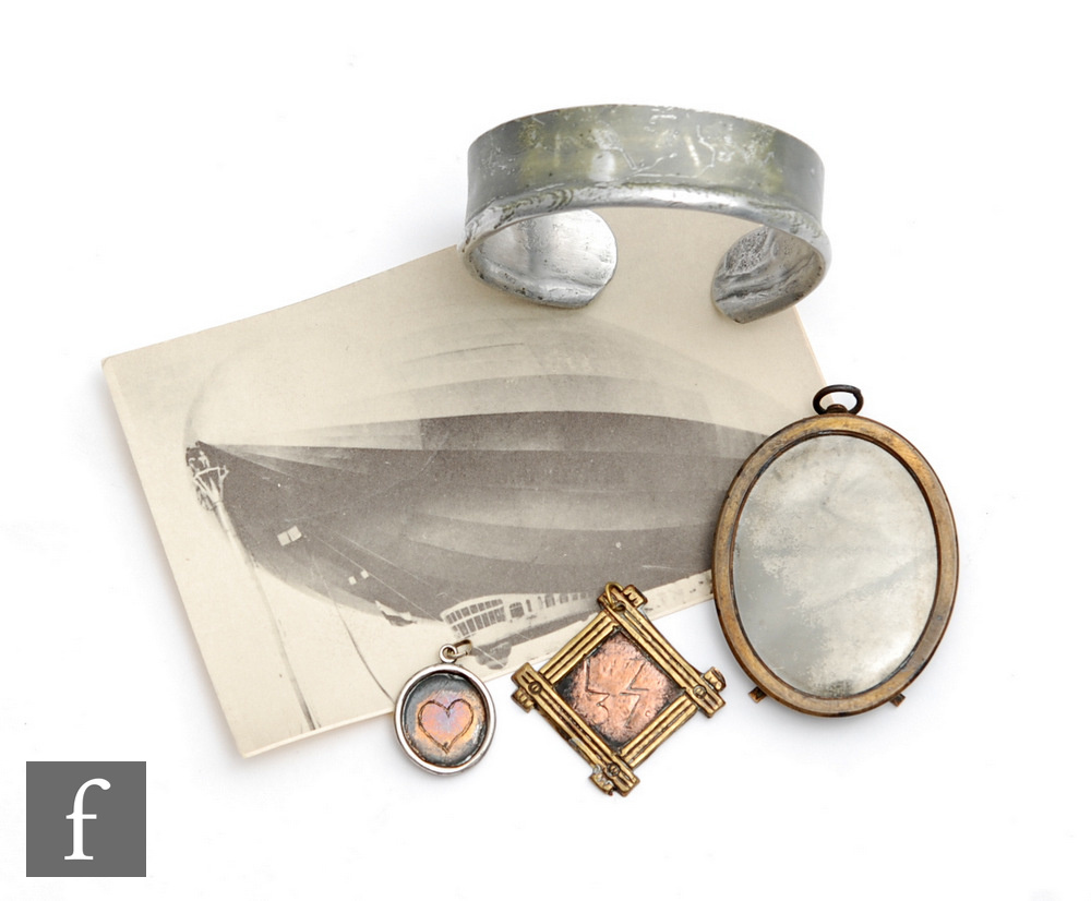 A collection of relics from the zeppelin airship LZ37 to include a piece of fabric mounted in an