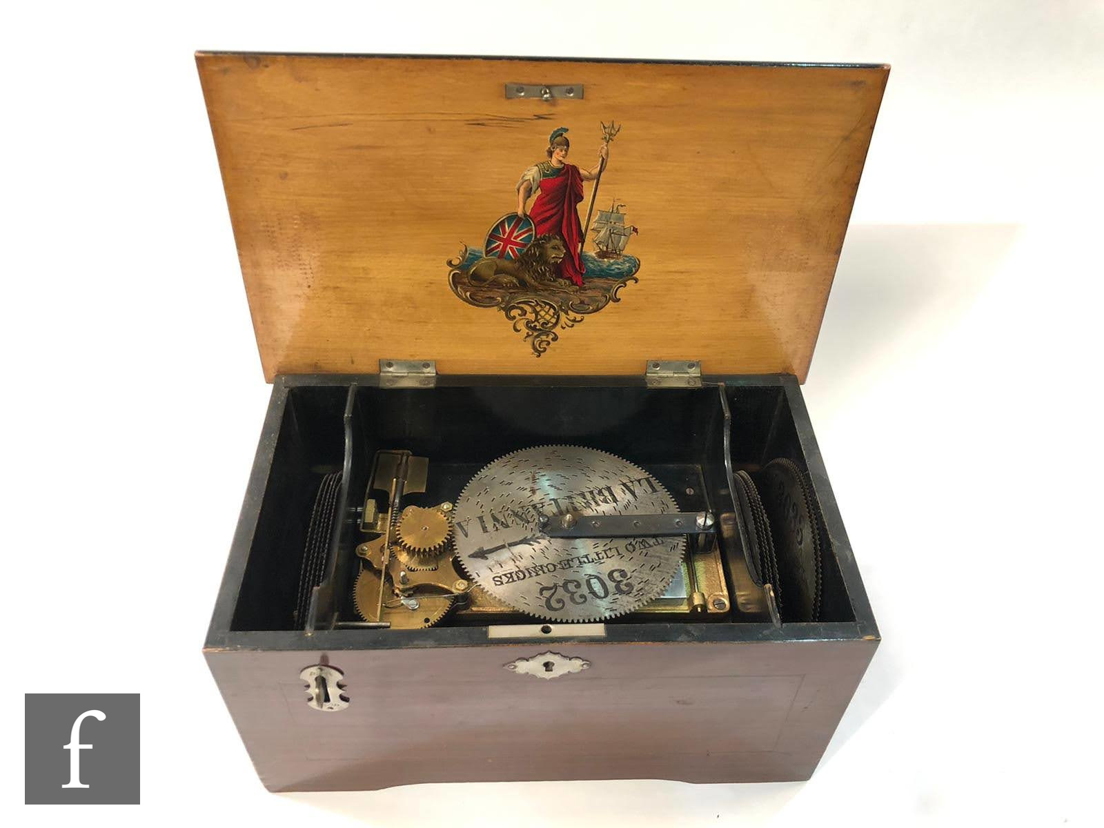 A Britannia disc musical box playing 5 inch discs, lever operation, transfer detail to lid and - Image 2 of 2