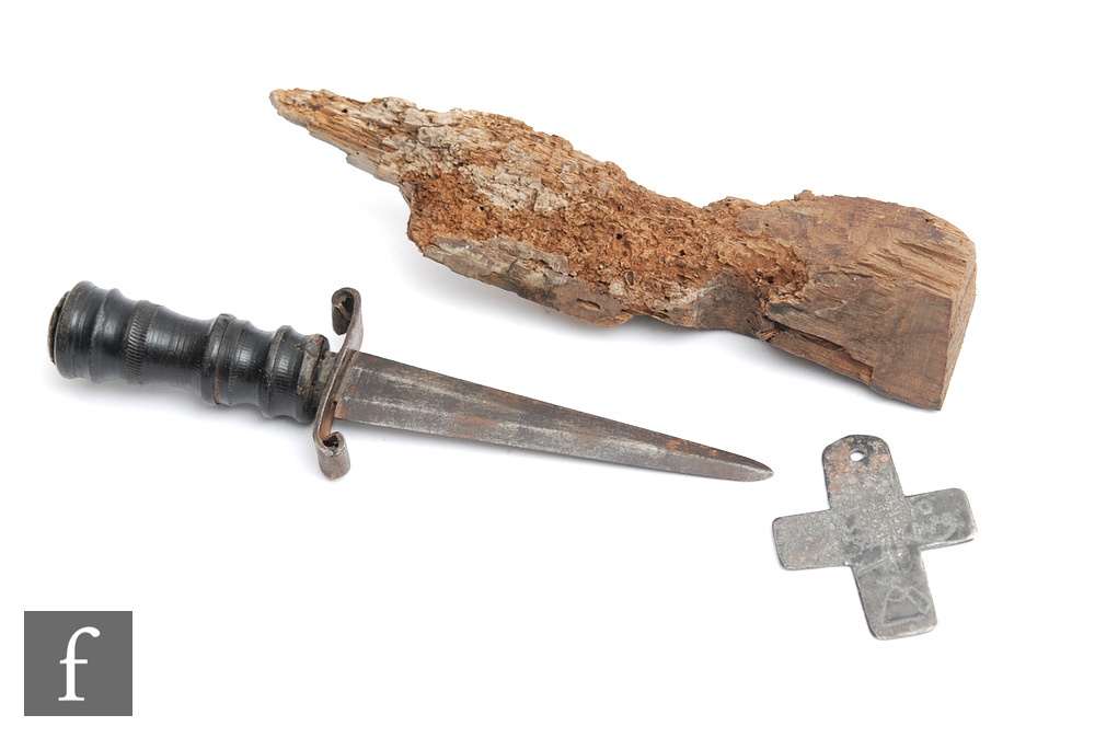 A crudely worked lead cross inscribed 'Death to ye King' with axe and block, height 7cm, also a