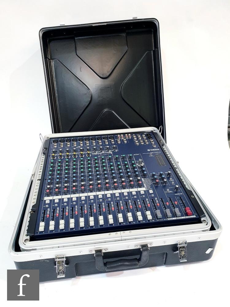 A Yamaha MG 166CX console mixing console, complete with Stagg hard case, together with Peavey