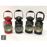 A SER black painted hand lamp and three BR (SR) hand lamps including a red painted example. (4)