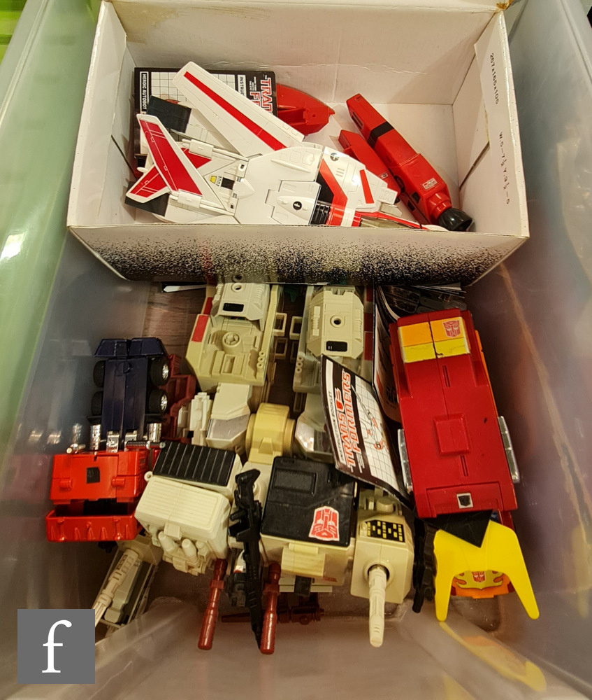 A collection of Habsro Transformers, all G1, to include Metroplex (complete besides small laser