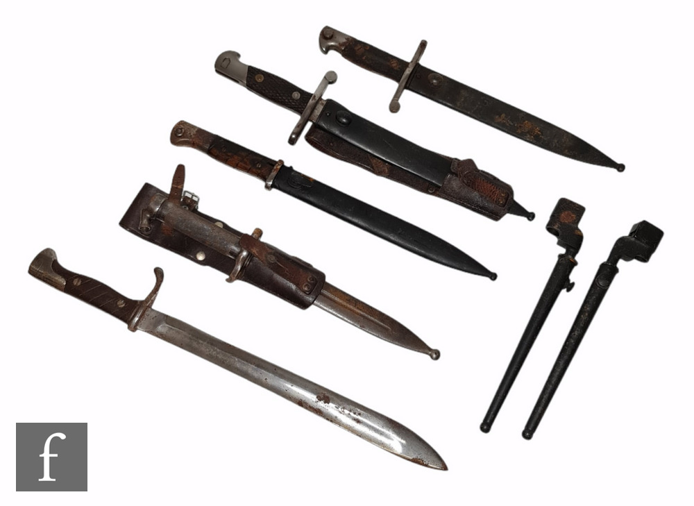 Two Spanish bayonets and scabbards both marked Toledo and stamped 3618 C and 4385 C, (both scabbards
