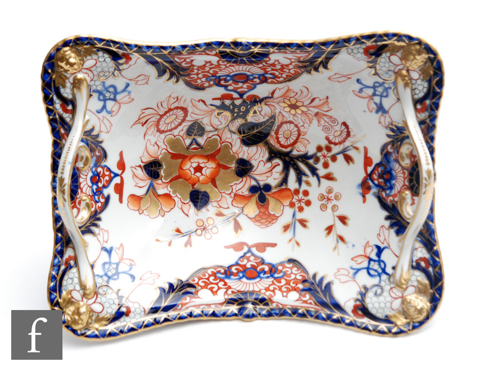 A large 19th Century Derby rectangular twin handled comport or footed basket decorated in the